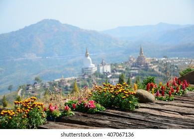Landscape focus flower and blur phasornkaew temple beautiful outdoor of Khaokhor Thailand