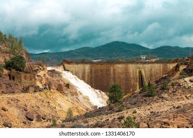 Landscape of the former Rio Tinto mine. Dam of a flotation tank near the town of Nerva. Post-mining and reclamation areas.