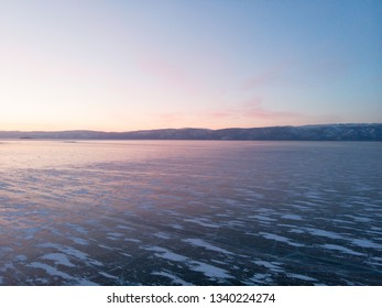 Landscape of Frozen Lake Baikal in the evening with light of sunset