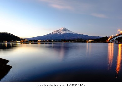 Landscape of Fuji Mountain. Iconic and Symbolic Mountain of Japan, snow behind clear blue sky background and front a reflection in water lake.