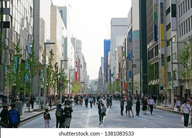 """The landscape of Ginza in Tokyo, Japan, the letter of the plate next to the traffic light shows the name of the town """"Ginza 2-chome""""."""