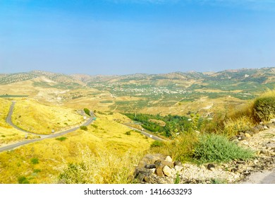Landscape of the Golan Heights, winding road 98, and the Yarmouk River valley, near the border between Israel and Jordan