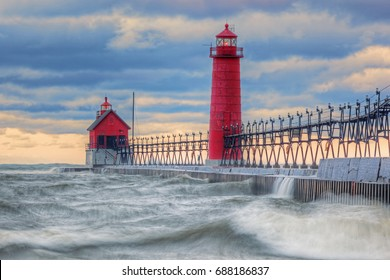 Landscape of the Grand Haven Lighthouse, pier, and catwalk at dawn, Lake Michigan, Michigan, USA