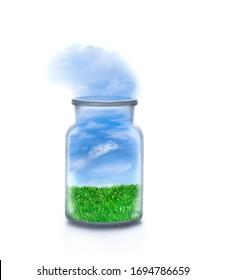 Landscape with grass inside a chemical bottle on white background. Friendly sky atmosphere flowing outside. Funny ecological and sustainable concept.