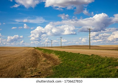 Landscape of a gravel road on the prairies
