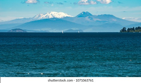 The landscape of great lake Taupo the largest freshwater lake in New Zealand with the volcanic landscape of Tongariro national park at the background.
