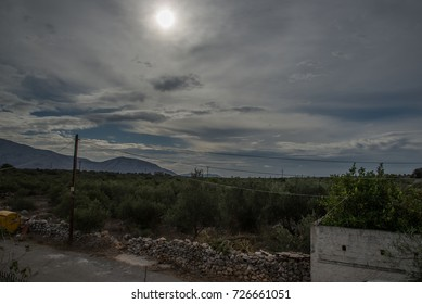A landscape of a Greek village on a cloudy day.
