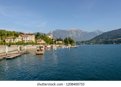landscape of green Como lake with Grigna range looming in background