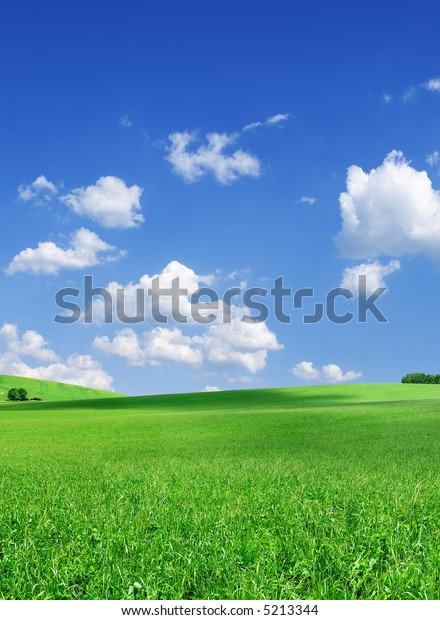 Landscape - green hills, fields the blue sky and white clouds