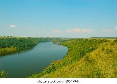 landscape with green hills and river