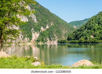 Landscape with green hills and the river Drina, which flows from the mountains
