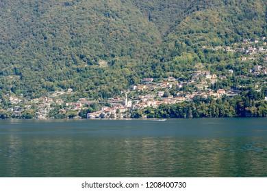 landscape of green lake coast of Como lake with Nesso village