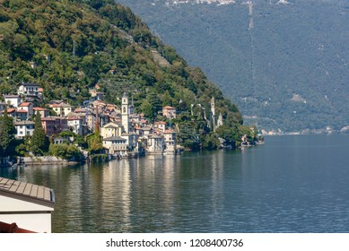 landscape of green lake coast of Como lake with Brienno village