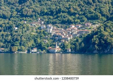 landscape of green lake coast of Como lake with Pognana Lario village