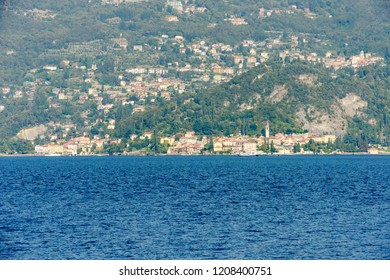 landscape of green lake coast of Como lake with Varenna village