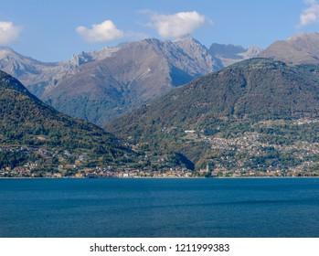 landscape of green lake coast of Como lake with Dongo village