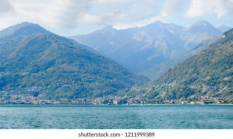 landscape of green lake coast of Como lake with Gravedona village