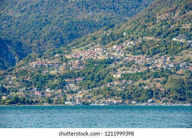 landscape of green lake coast of Como lake with Vercana hill village