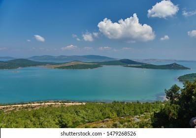 Landscape of green nature and blue sea from the hill Seytan Sofrasi (devil's table), Ayvalik, Balikesir, Turkey.