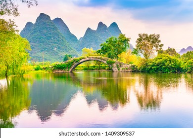 Landscape of Guilin, Ancient Bridge and Karst mountains. Located near Yangshuo, Guilin, Guangxi, China.