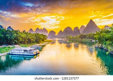 Landscape of Guilin, Li River and Karst mountains. Taken from Yangshuo Bridge. Located in Yangshuo, Guilin, Guangxi, China.