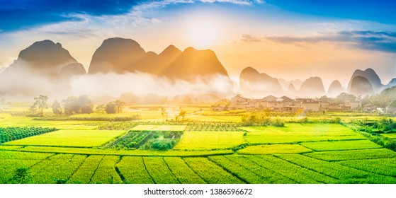 Landscape of Guilin, rural areas. Karst mountains, farmland and small villages. Located near Yangshuo, Guilin, Guangxi, China.