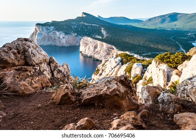Landscape of the gulf of capo caccia from the Cave of broken vessels at sunset