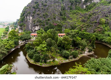 Landscape Hang Mua (Mua Cave) in NinhBinh with impressive panoramic view of golden rice fields, limestone mountains, Vietnam, Tamcoc view from Mua cave.