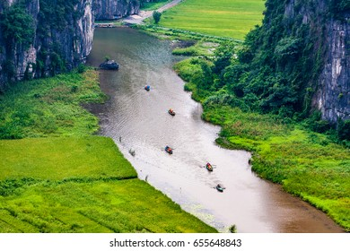 Landscape Hang Mua (Mua Cave) in NinhBinh with impressive panoramic view of golden rice fields, limestone mountains, Vietnam, Tamcoc view from Mua cave.Boat trip on Ngo Dong river in Tam Coc, VietNam.