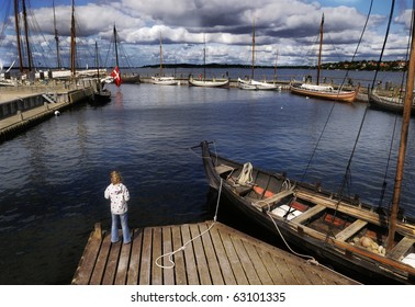 Landscape in harbour of denmark with sailboats and child