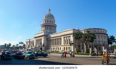 Landscape of Havana. Capitol building in Havana on a sunny day and local old cars waiting at the traffic lights. Havana, Cuba. January 2011.