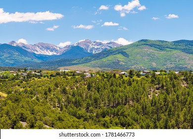 Landscape high angle panoramic cityscape view during summer from High Road to Taos of mountains and village called Truchas in New Mexico, USA