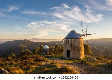 Landscape of Historical Windmills in Penacova Portugal (Moinhos de Gavinhos) with Mountains at Sunset