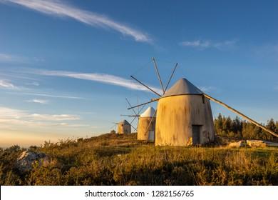 Landscape of Historical Windmills in Penacova Portugal (Moinhos de Gavinhos) on Hill at Sunset