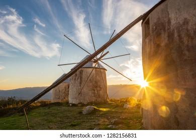 Landscape of Historical Windmills in Penacova Portugal (Moinhos de Gavinhos) with Sunburst at Sunset