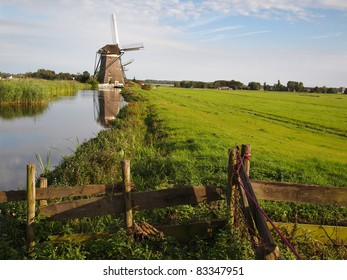 Landscape in Holland with windmills and a canal.