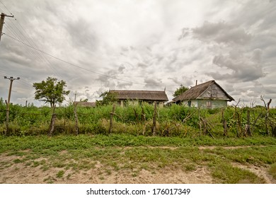 Landscape with houses in a cloudy day from Letea village, in the Danube Delta area, Romania