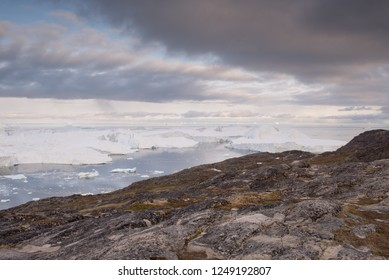 Landscape in Ilulissat, Greenland, with icebergs and coastline