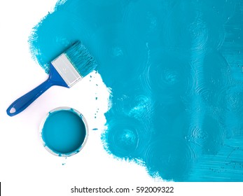 Landscape image blue paint brush with blue splash and can. top view with copy space