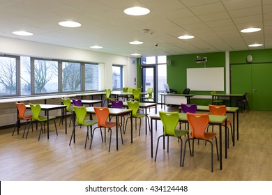 Landscape image of an empty classroom.
