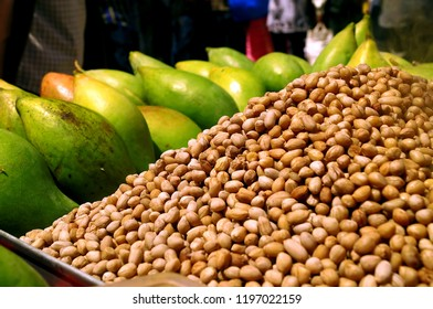 Landscape image of healthy evening eateries like mango and groundnuts for sale on a street side stall in the Bangalore market in Karnataka,India