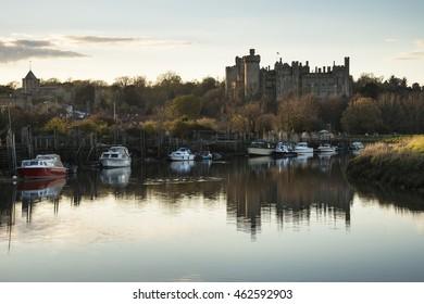 Landscape image of medieval Castle viewed across River at sunset.