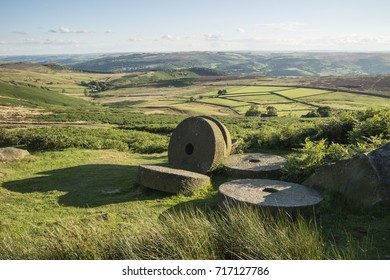 Landscape image of millstones on top of Stanage Edge in Peak District