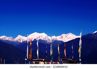 Landscape image of the mountain range of Kanchenjunga with waving flags in the foreground as seen from Pelling view point  in the Indian state of Sikkim