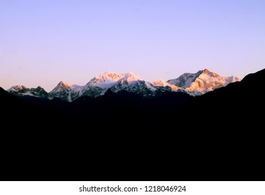 Landscape image of the mountain range of Kanchenjunga as seen from Pelling view point during early hours of sunrise in the Indian state of Sikkim