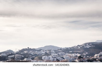 landscape image of mountains and buildings in almunecar spain
