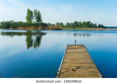 Landscape with the image of pier on lake Seliger in Russia