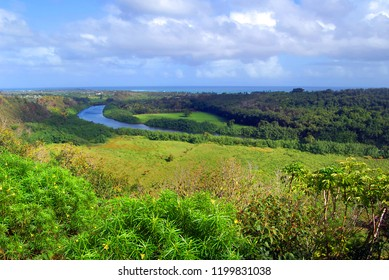 Landscape image shows the Wailua River as it curves toward the ocean on the Island of Kauai, Hawaii.