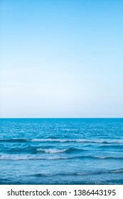 Landscape image of tropical white beach with blue sky background