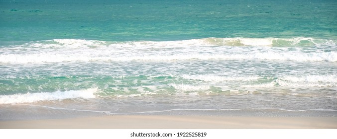 Landscape image of tropical white beach and the blue sea